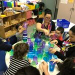 Children at Donahue School count using 100 cups