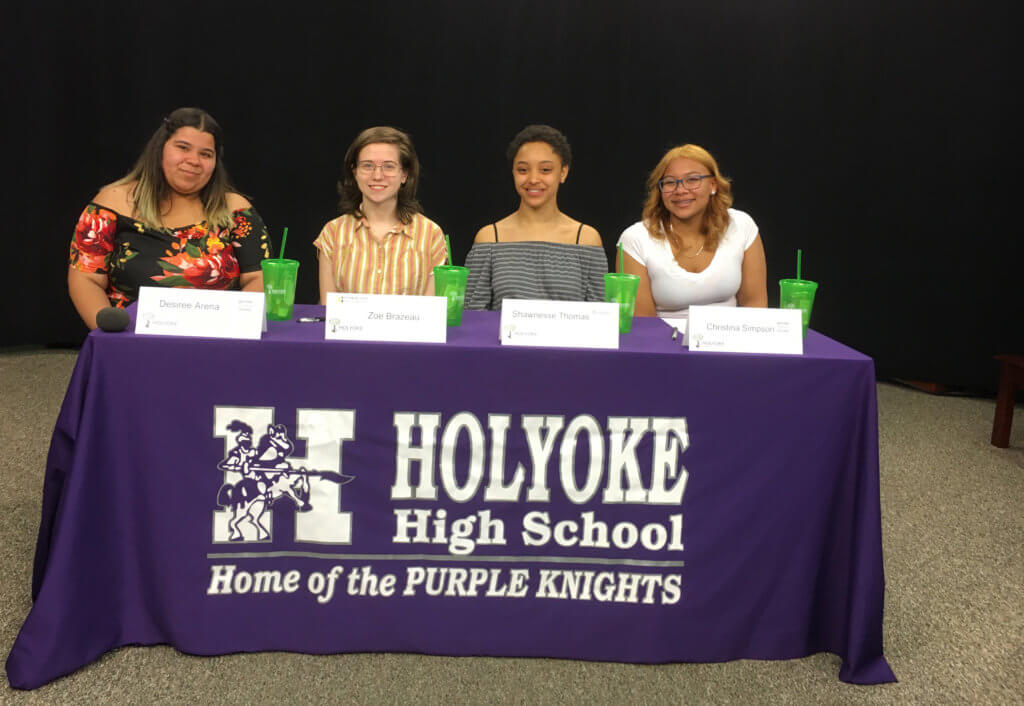 future educators 2019 graduating seniors signing to commitment letters - four high school female students from Holyoke High School