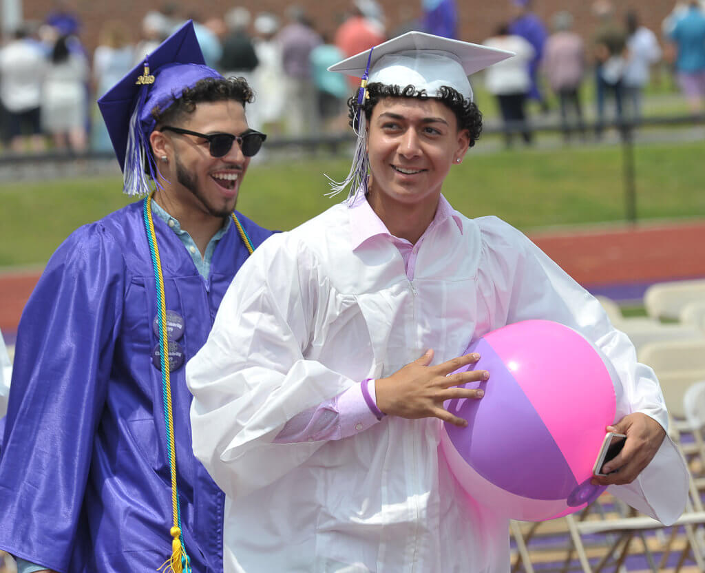 2019 HHS graduation 2 male students with beach ball
