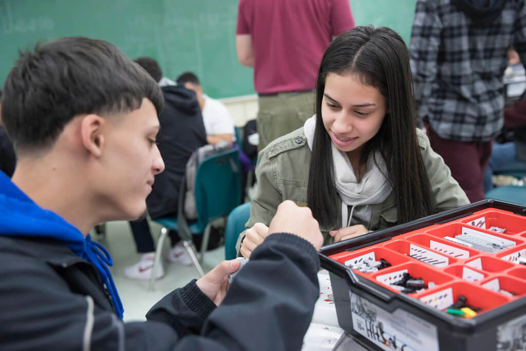 male and female high school students working together