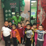 Morgan students posing with The Hulk as part of their MCAS Superhero celebration.