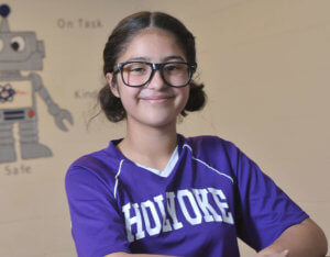 Stem Academy female student smiling wearing a purple Holyoke athletic shirt 2019 Rising Star.