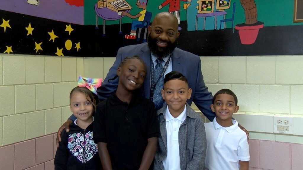Morgan school principal and 4 students smile for the first day of school