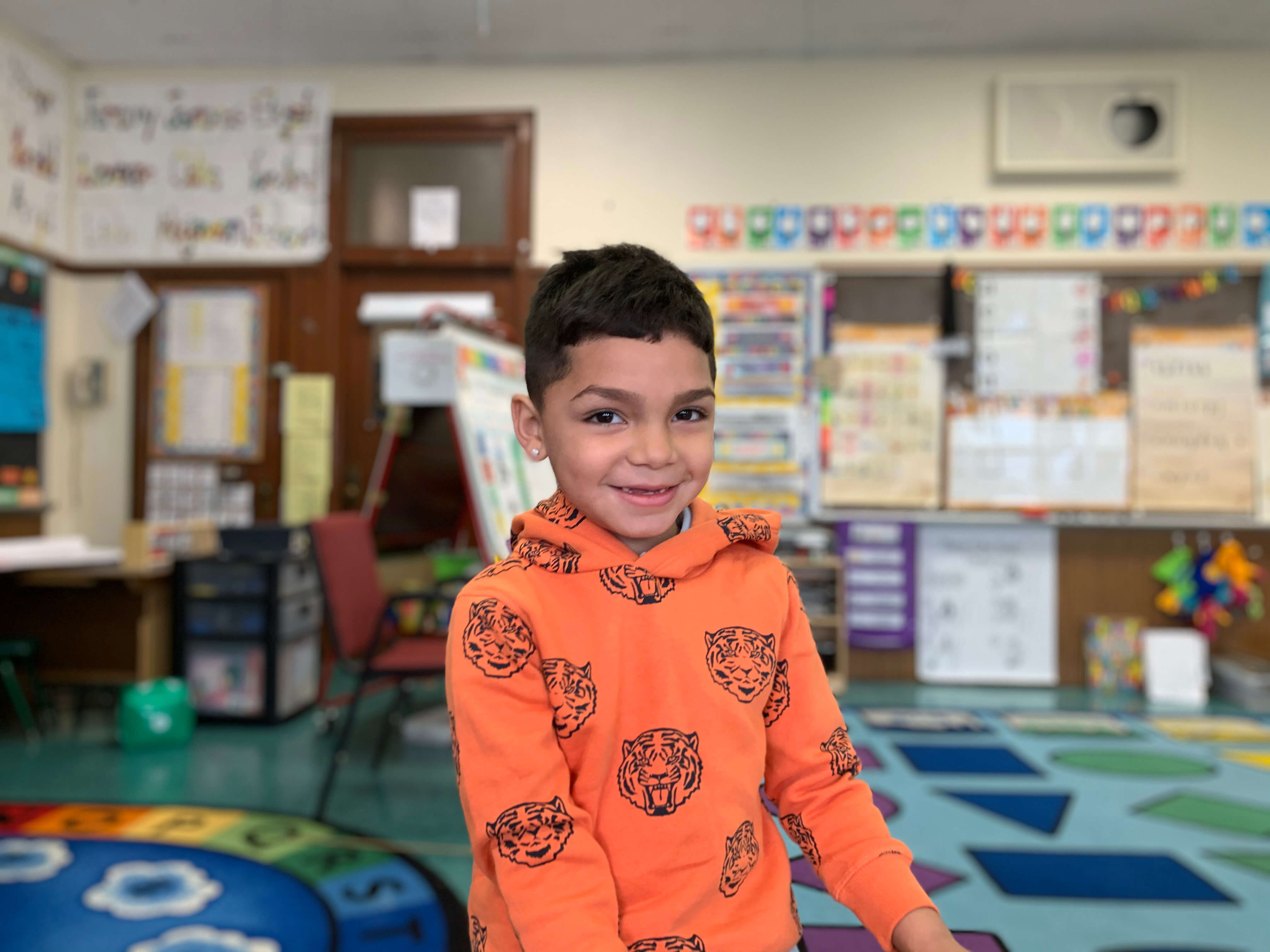 Young elementary student smiling for the camera