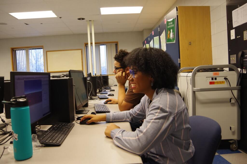 Two Holyoke High School students using computers