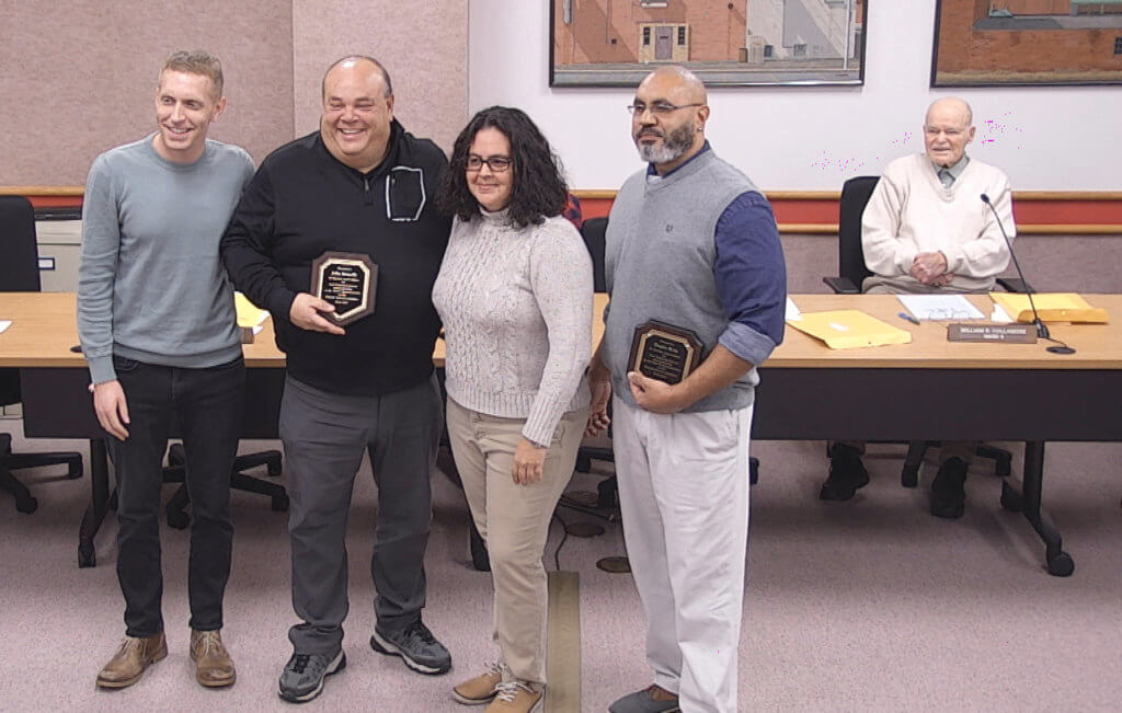 John Brunelle and Dennis Birks pose with their plaques at the last schooll committee meeting