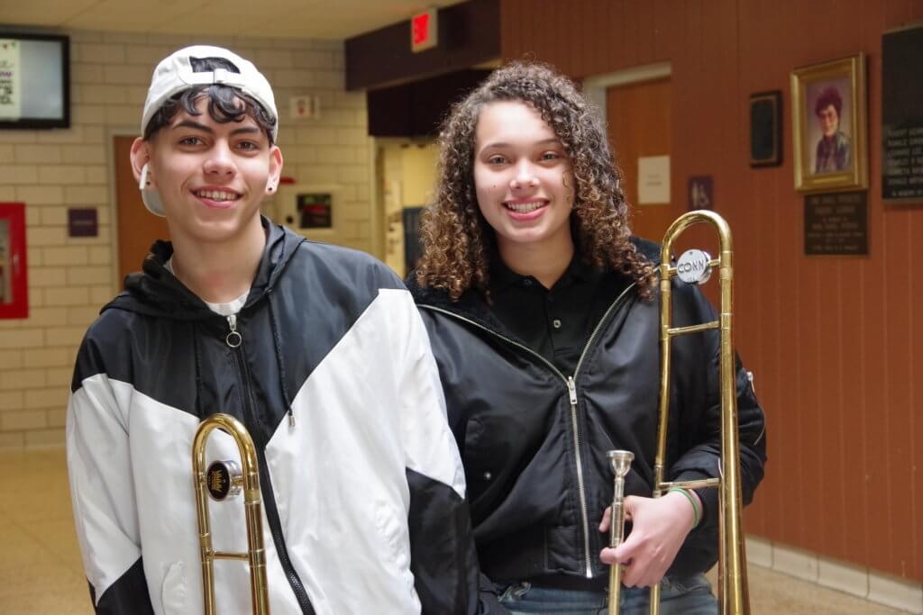 Two HHS band students posing with their trombones