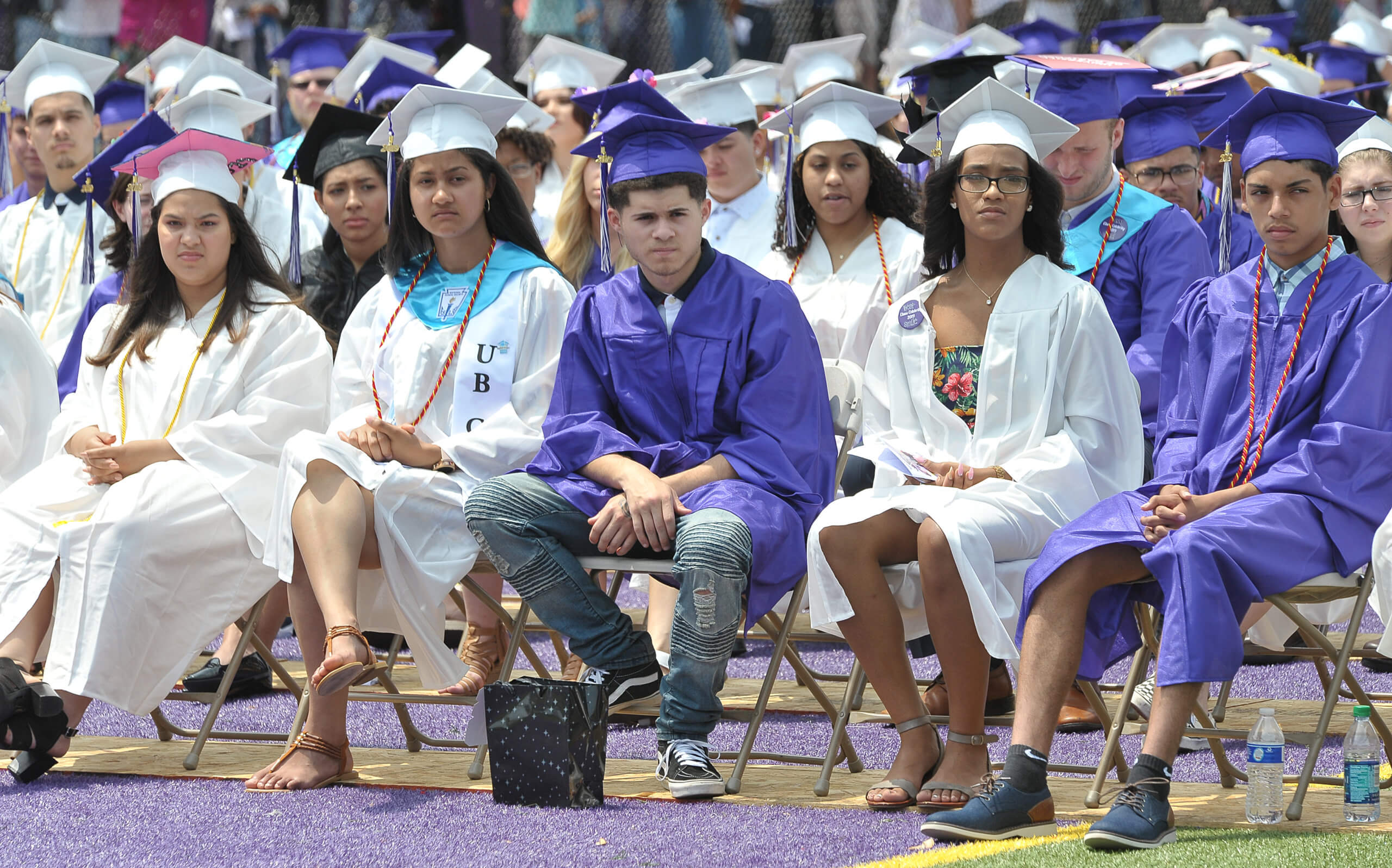 Students sitting at graduation.