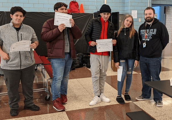 Holyoke High School students and faculty holding certificates