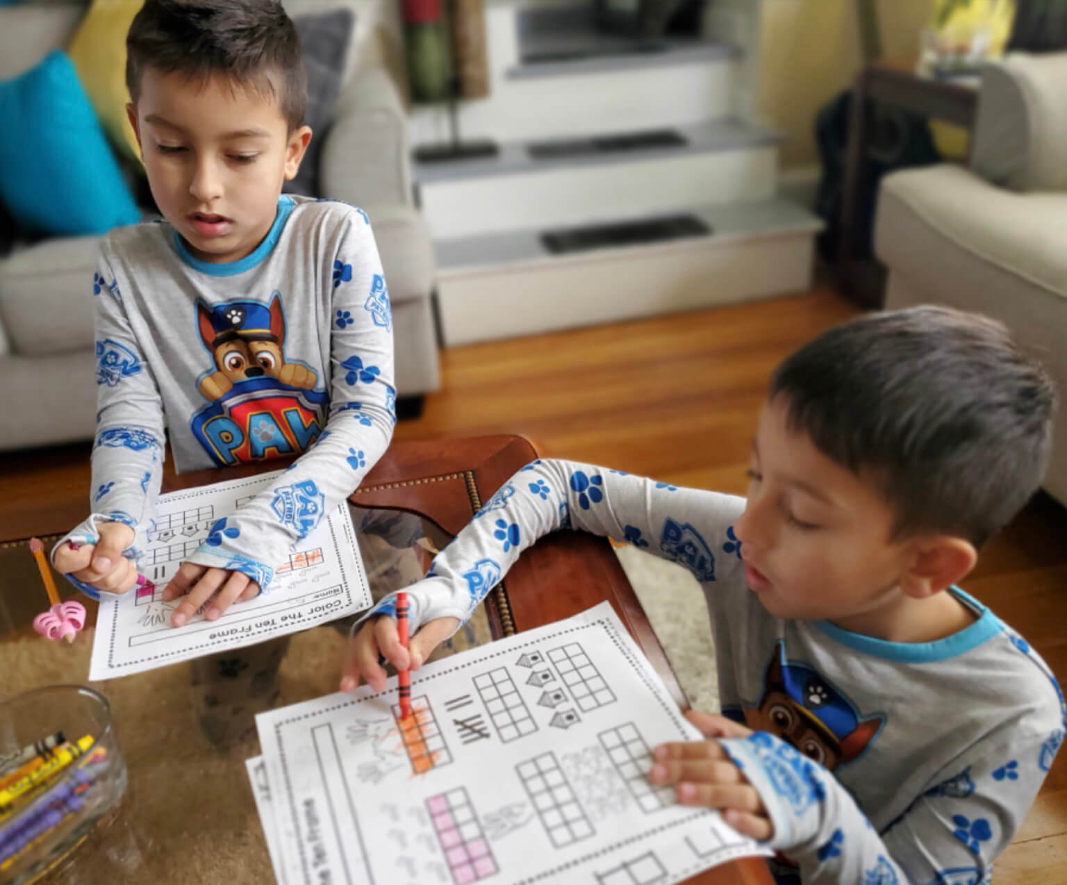 boys in pajamas doing schoolwork at home