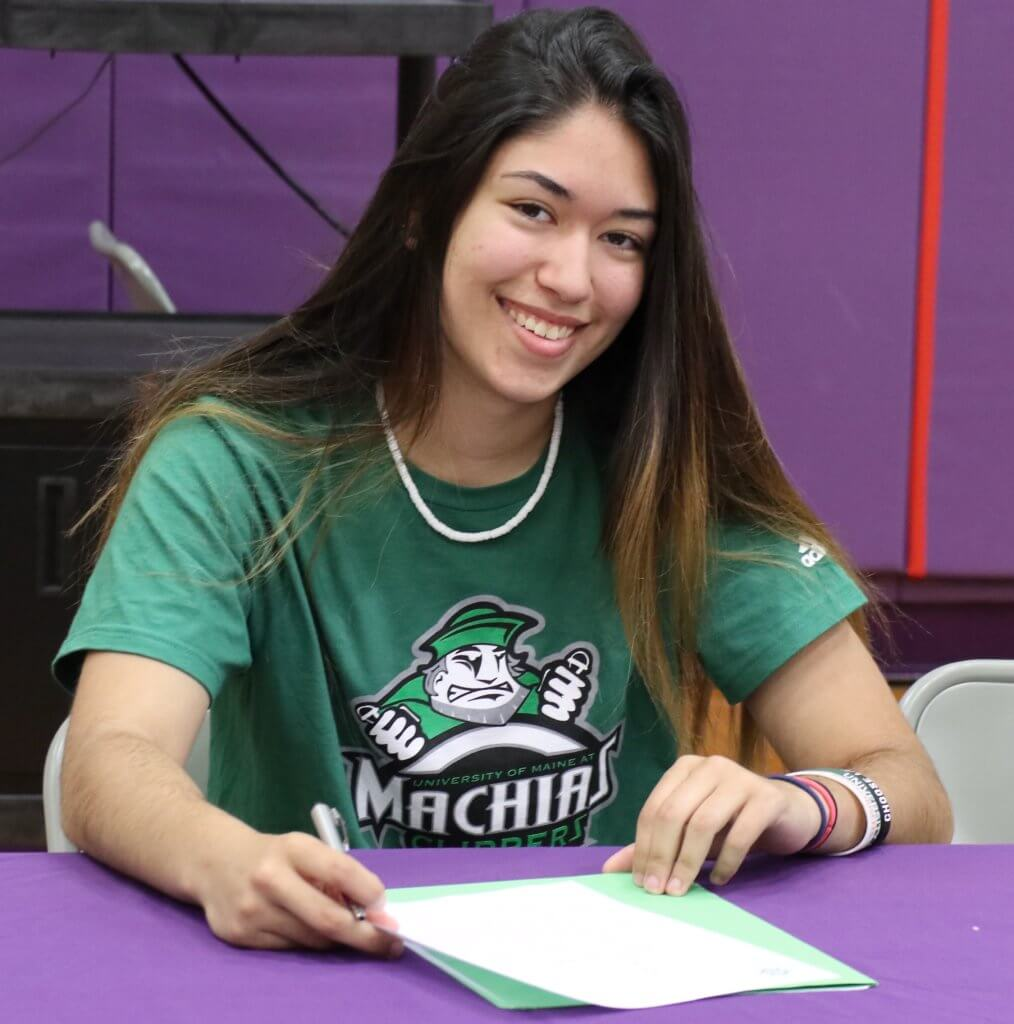 6-19-20 Holyoke Update senior female signing day in green t-shirt sitting at purple table