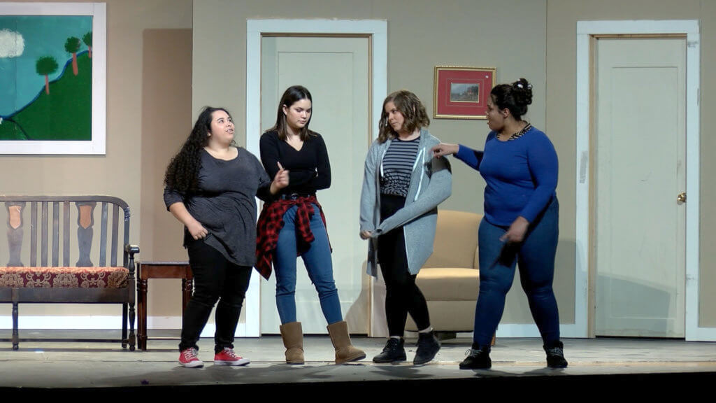 arts caught in the act 4 high school female students acting on stage