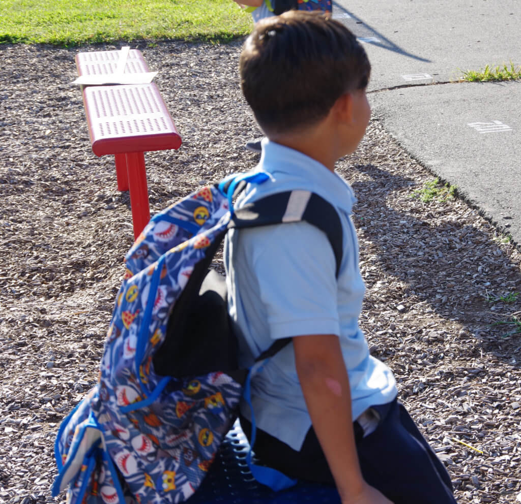 return to school back to school boy on bench with backpack