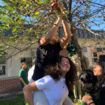 Students apple picking in the courtyard