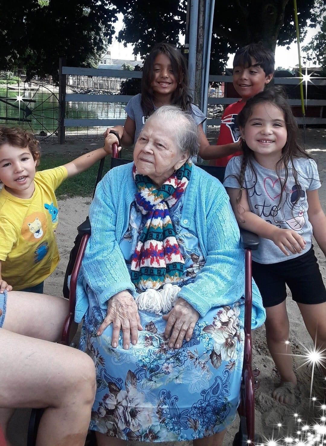 Celebrating Hispanic Heritage - abuela seated in blue surrounded by family