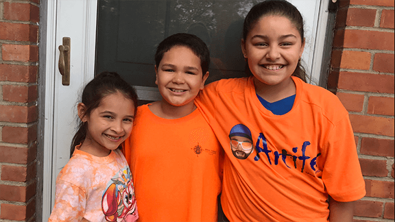 3 girls wearing orange in support of Unity Day - bullying prevention