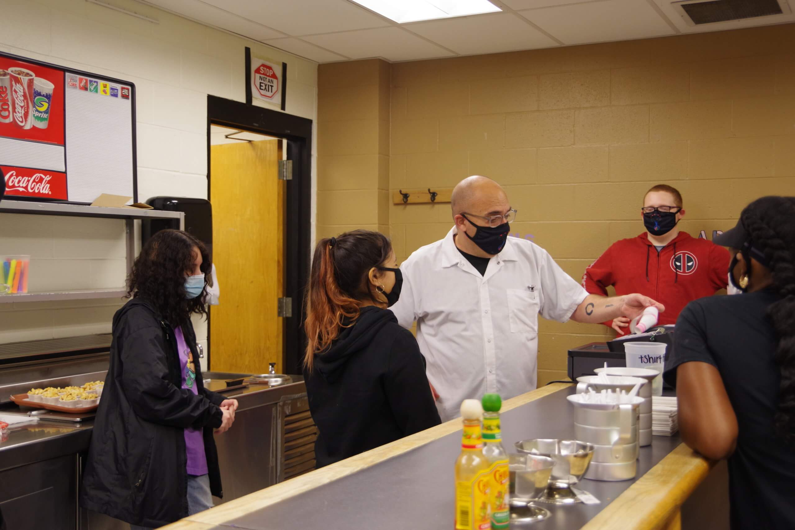Dean culinary students in shop