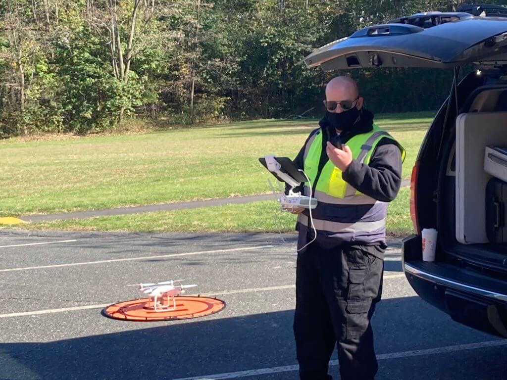MSBA, MASS DOT employee in yellow vest operating a drone