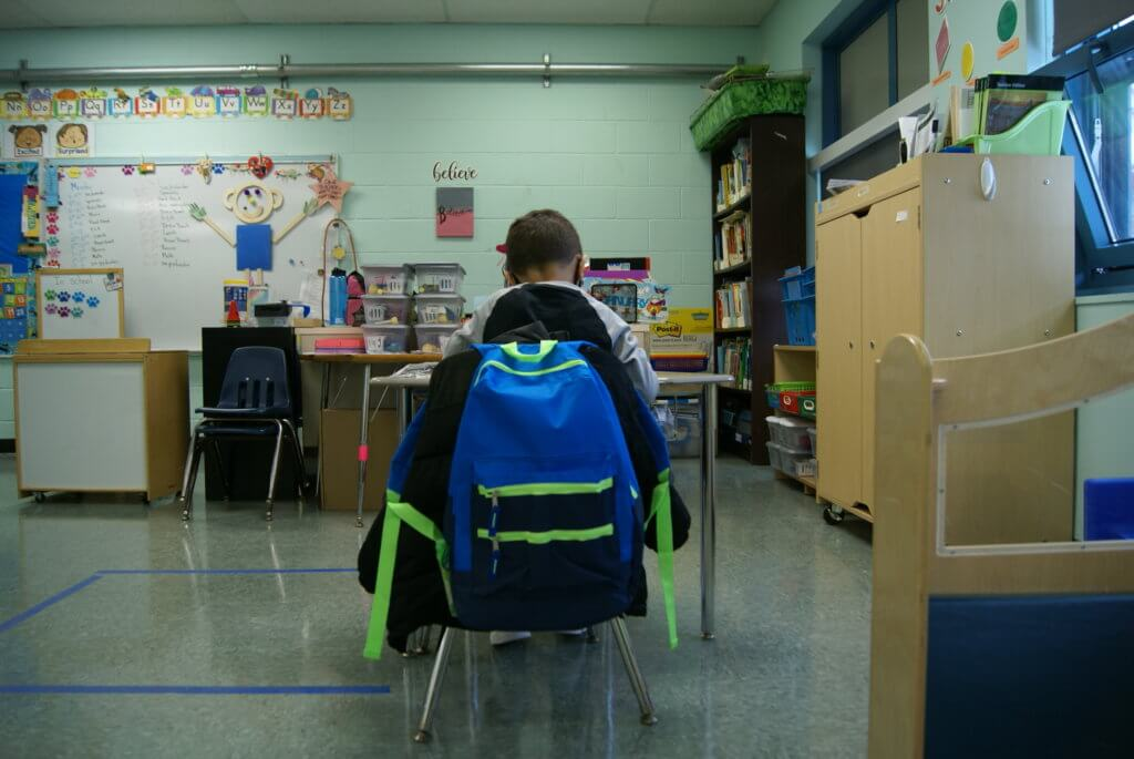 student engaged in in-person learning