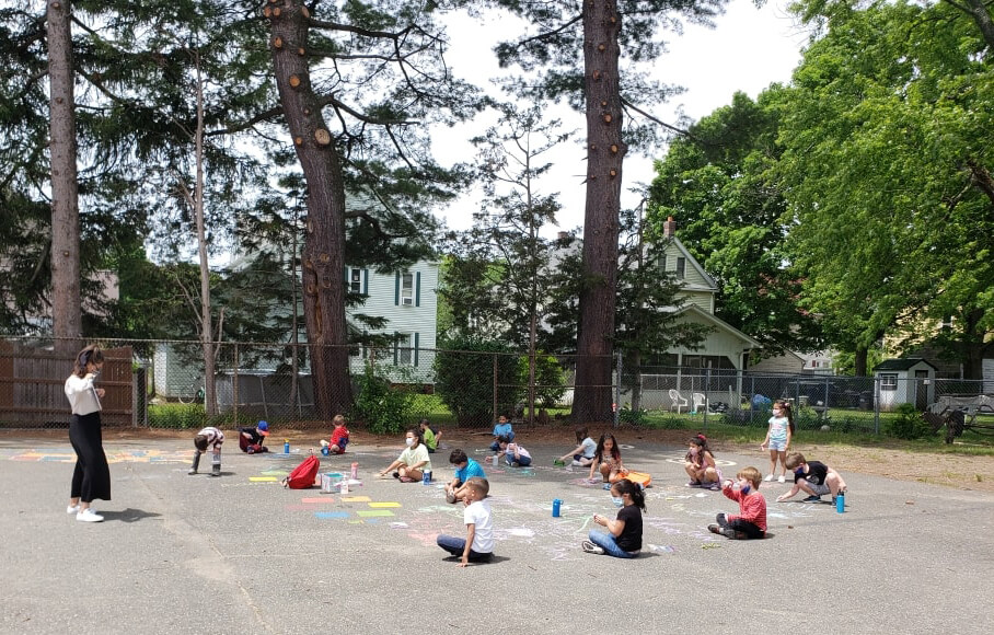 students engaged in outdoor learning
